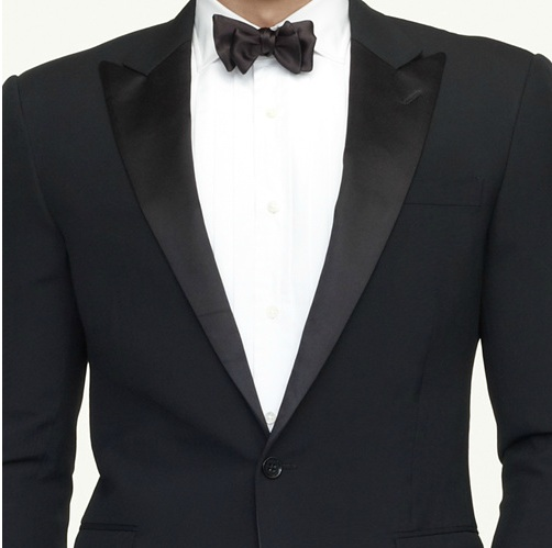 two piece tuxedo features a peak satin lapel and sloped shoulders with